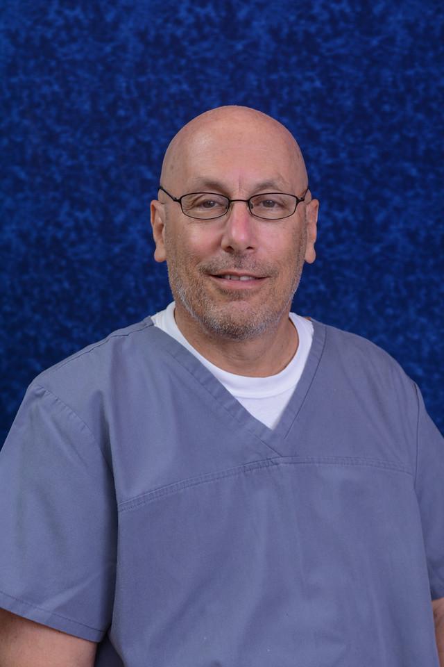 Dr. Alamar - Dentist & Clinic Director
